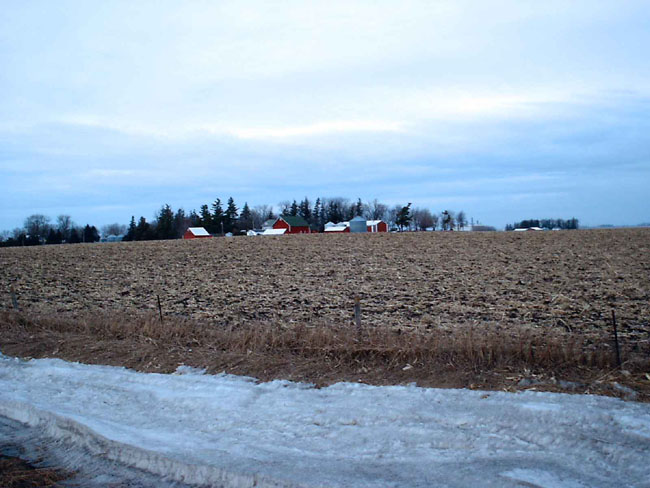 """Here are a couple pictures of a farm and an empty field. This is pretty much what all of Iowa looks like. If you notice we don't have any snow, at least in my area. Just cold."""