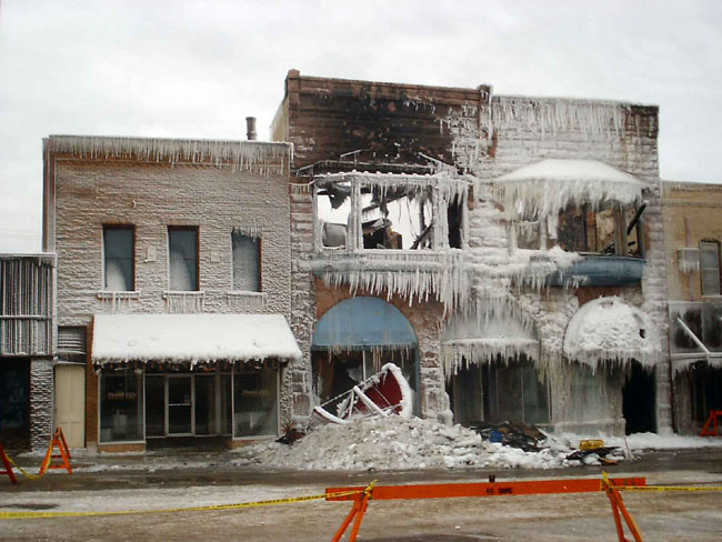 """This is a picture of a building on main street in Hampton, Iowa that burned the other night. It was around 6 below zero at the time of the fire."""