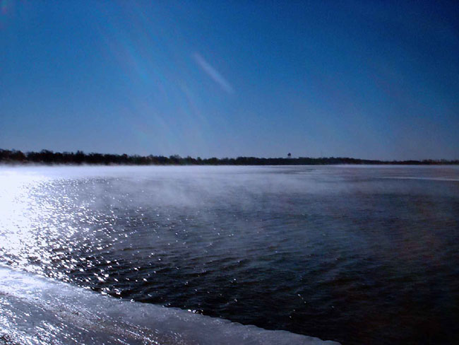"""It was a bright sunny day and very cold, around 26 below zero. I took these pictures of the steam rolling off Clear Lake."""