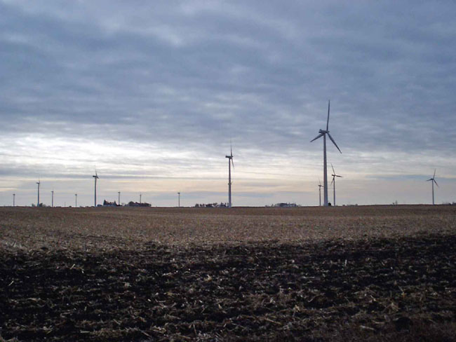 """This picture is of windmills in the middle of a field near Ventura, Iowa. Wind farms are popping up around the area."""
