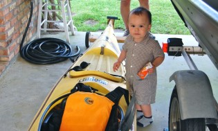 Marcel helps his daddy prepare the boat.