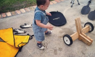 Marcel helps his daddy prepare the gear.